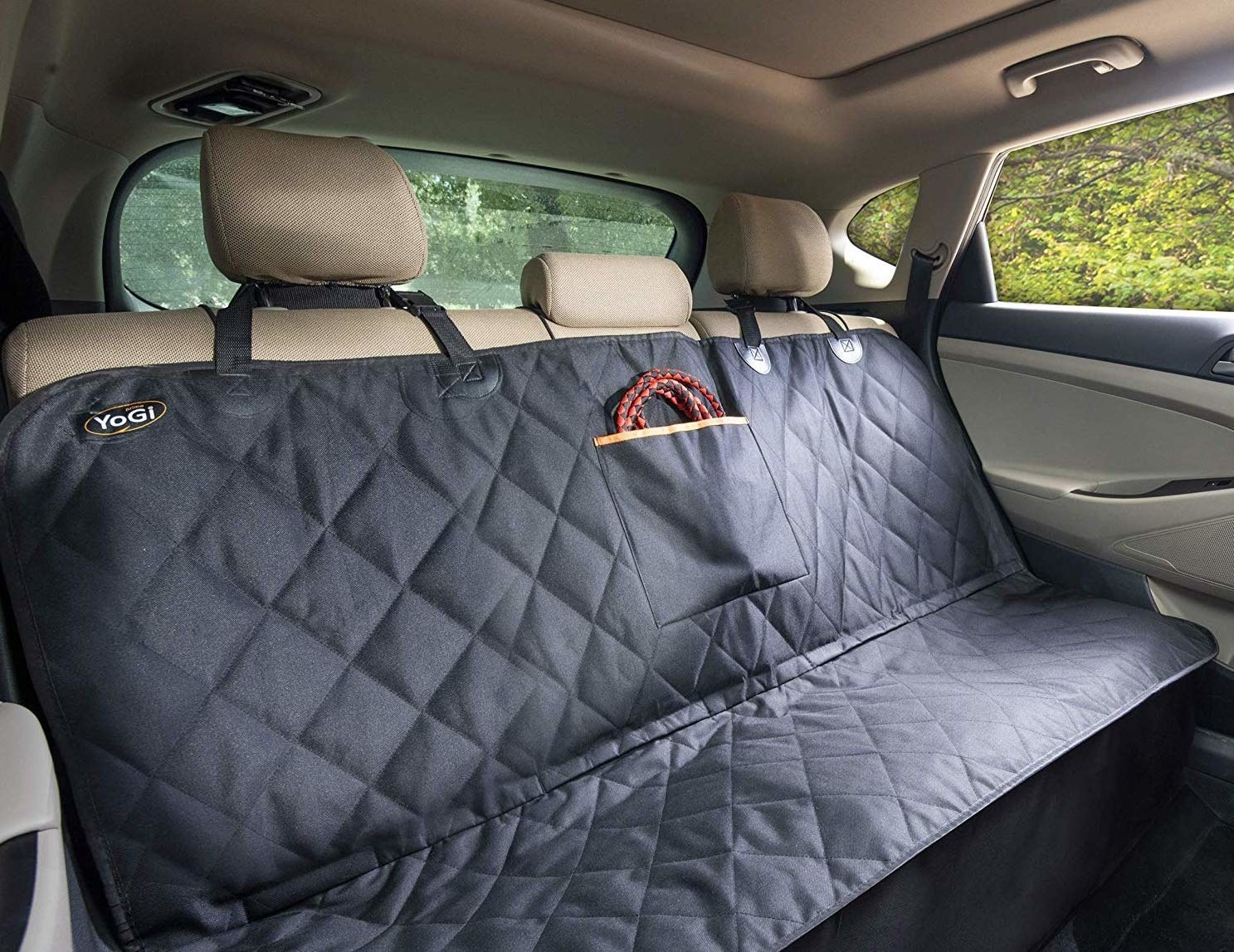 The backseat of a car with the car seat-cover on it