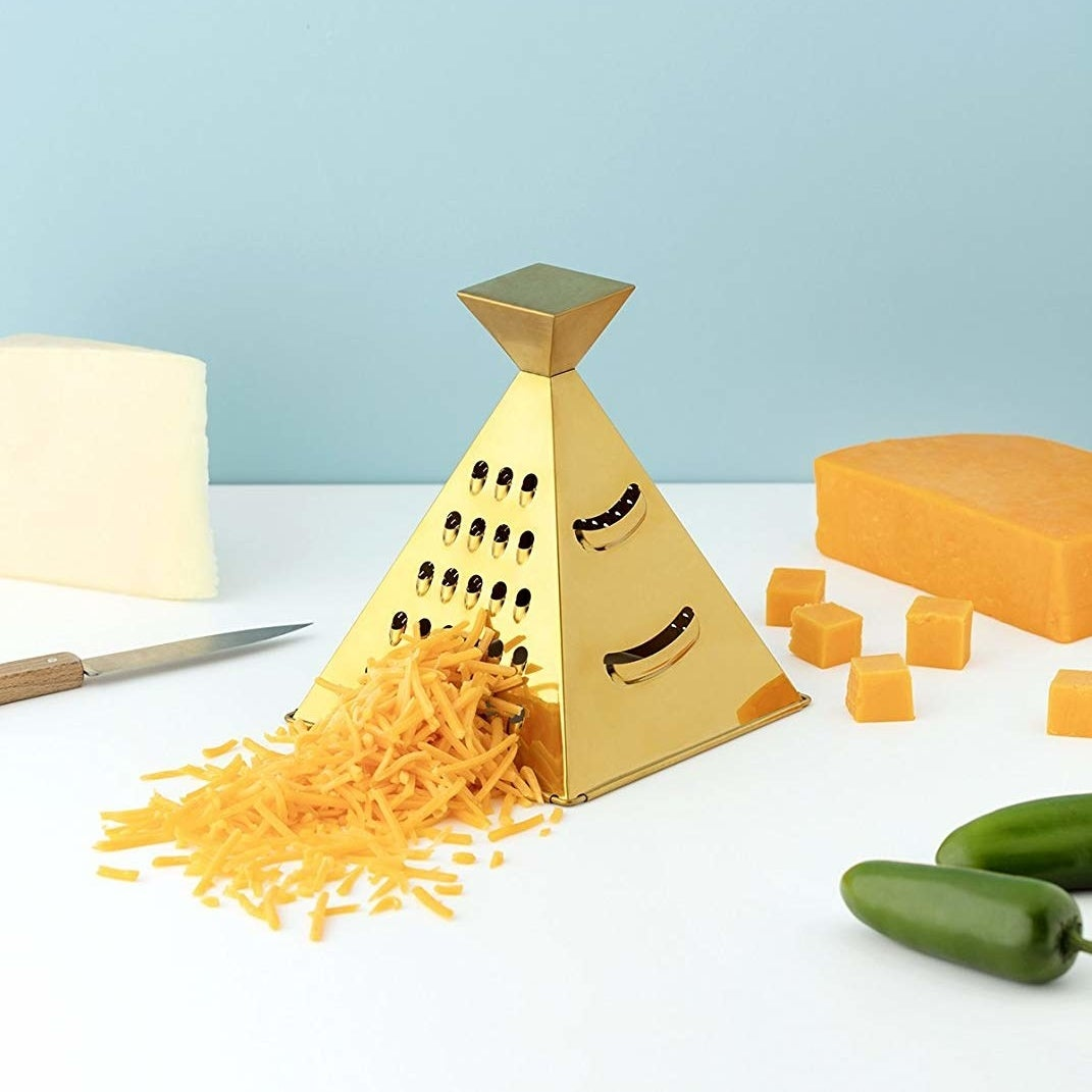 Stainless steel pyramid grating cheese
