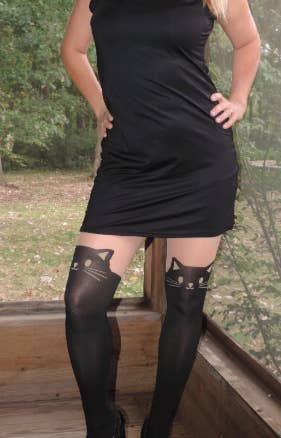 another reviewer wearing black cat stockings