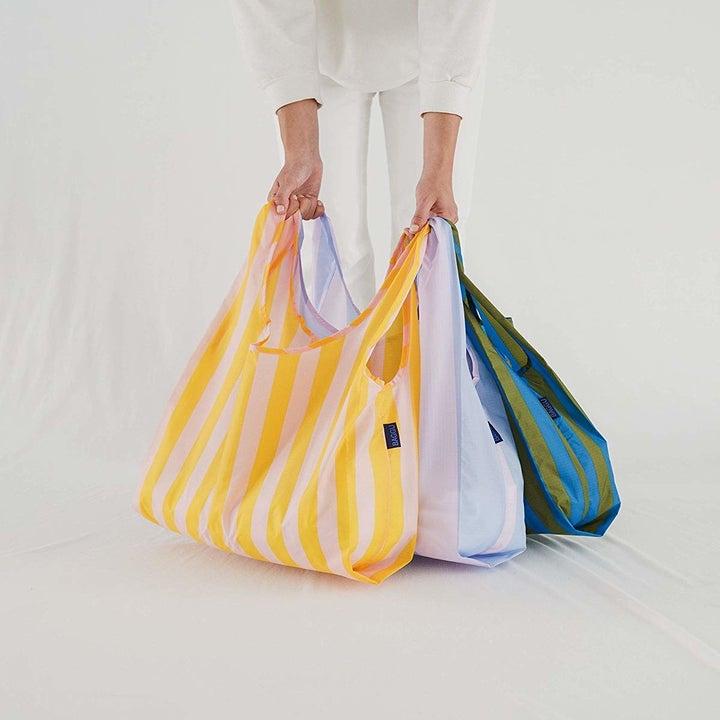 Model holding Baggu bags