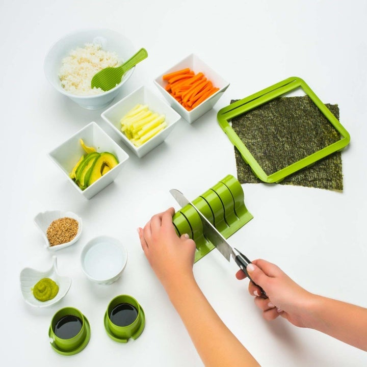 Model using the different components of the sushi-making kit