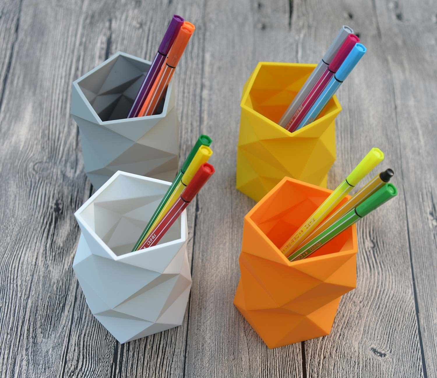 Geometric pencil containers in four shades