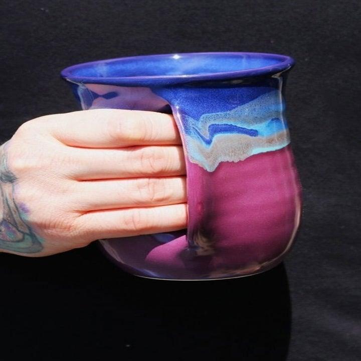 Hand-warming ceramic mug in pink/blue colorway