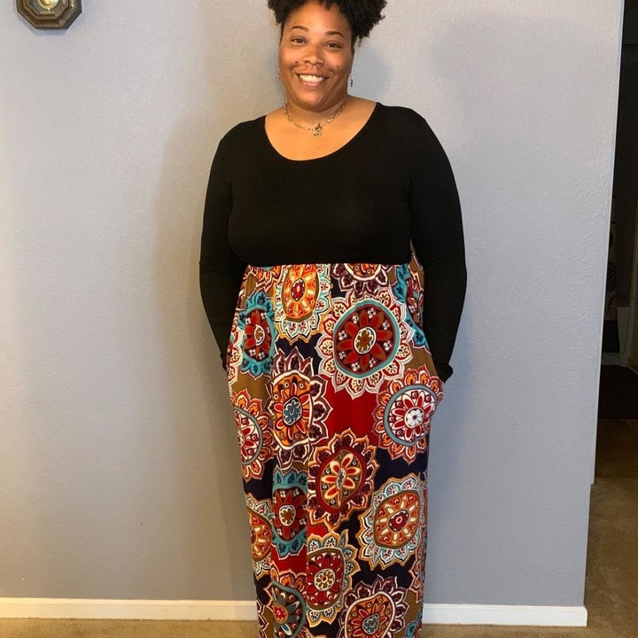Reviewer wearing the version with the black bodice and floral-print skirt