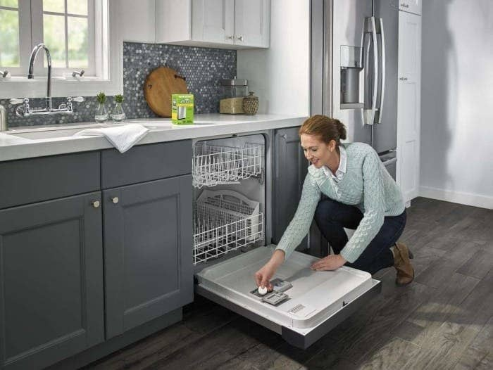 A model placing one of the tablets in a dishwasher