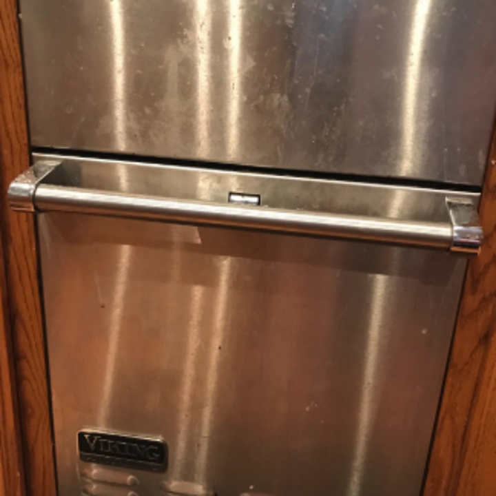a reviewer's stacked stainless steel oven covered in finger prints