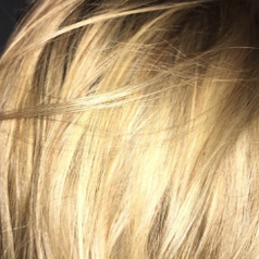 a reviewer's brassy blonde hair