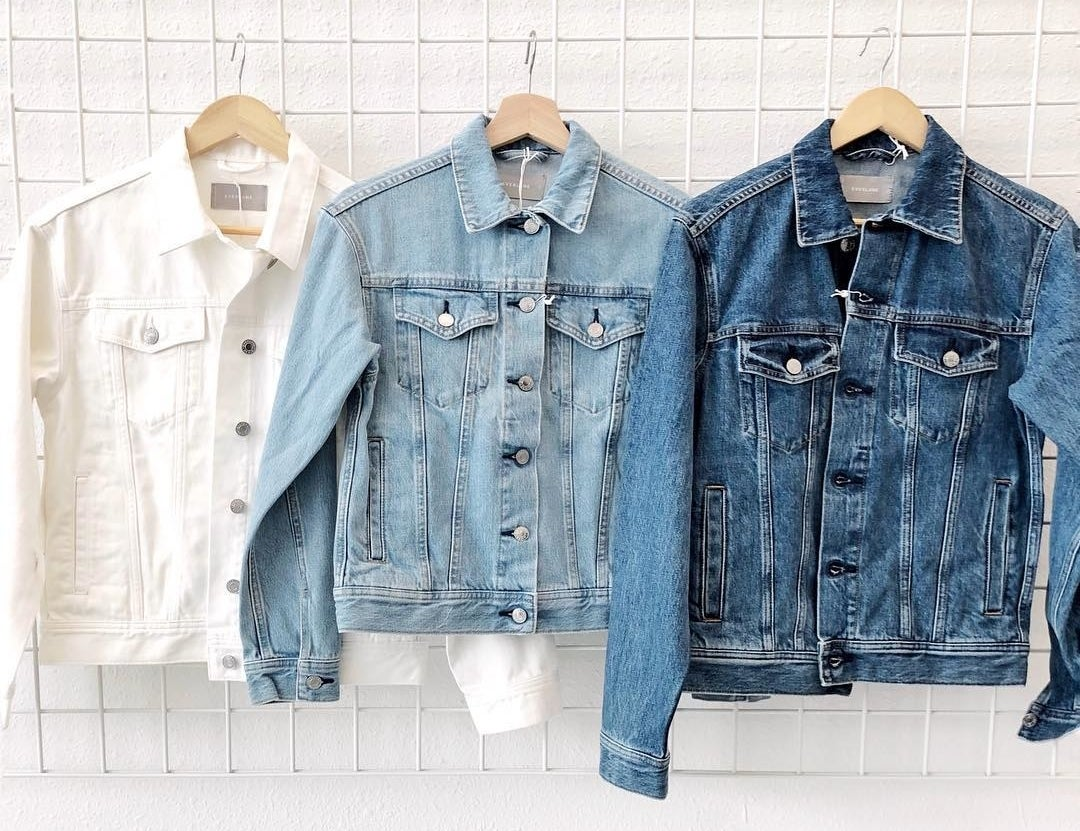 white, light blue, and dark blue denim jackets