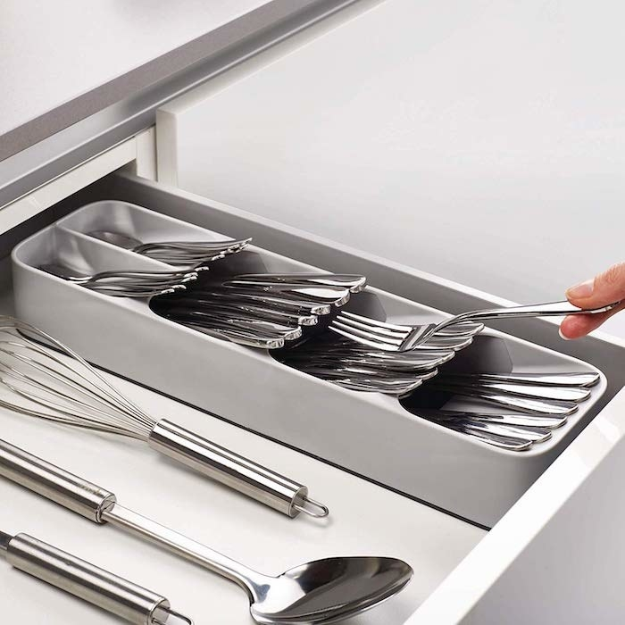 grey, skinny rectangular silverware organizer with five different sections