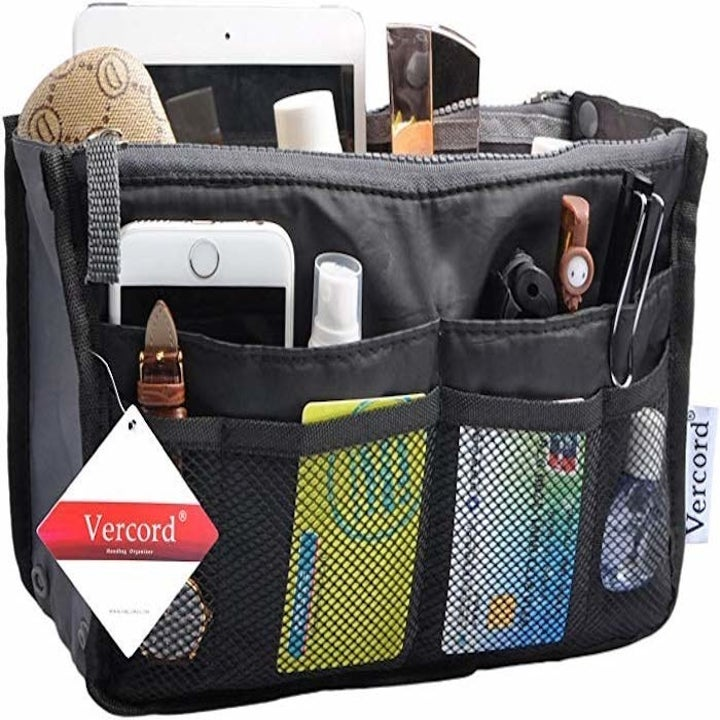 the organizer with a bunch of things slipped inside its compartments and side pockets