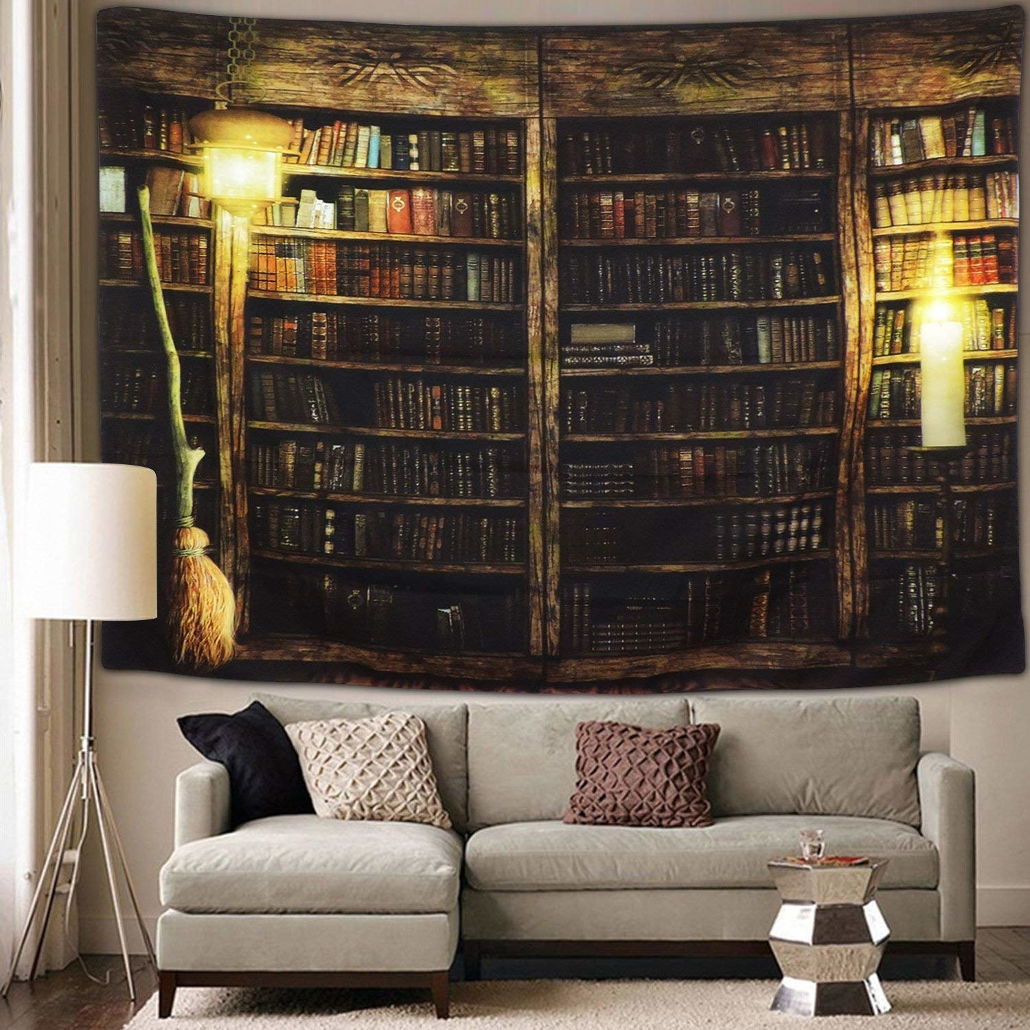 the book-inspired tapestry hanging behind a couch