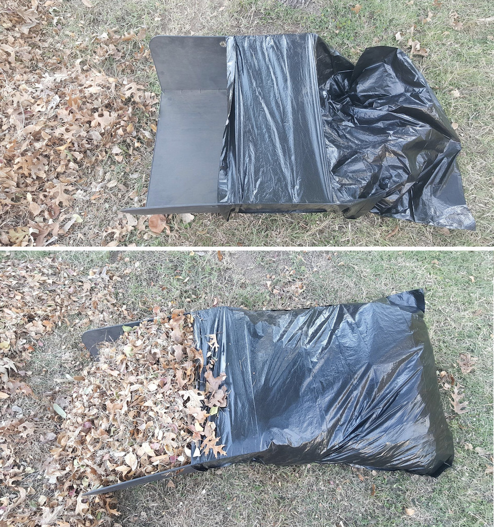 A reviewer's setup: the wide tri-fold presentation board-like product, made from plastic, inserted halfway into a plastic garbage bag, keeping it open wide. They've raked in a bunch of leaves from their pile, and the taco funnels them into the bag