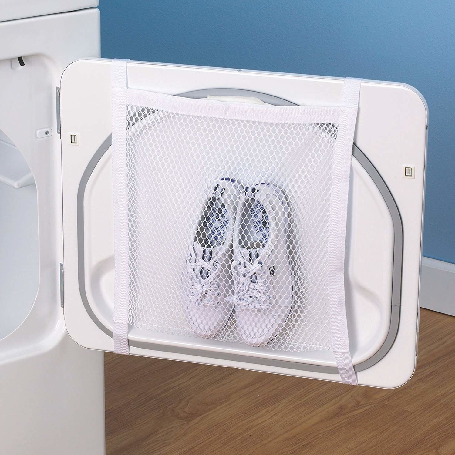 Square mesh pocket with two tennis shoes attached to inside washer door