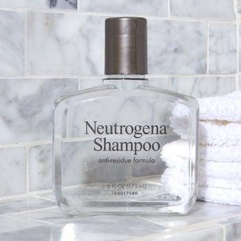 The clear shampoo bottle