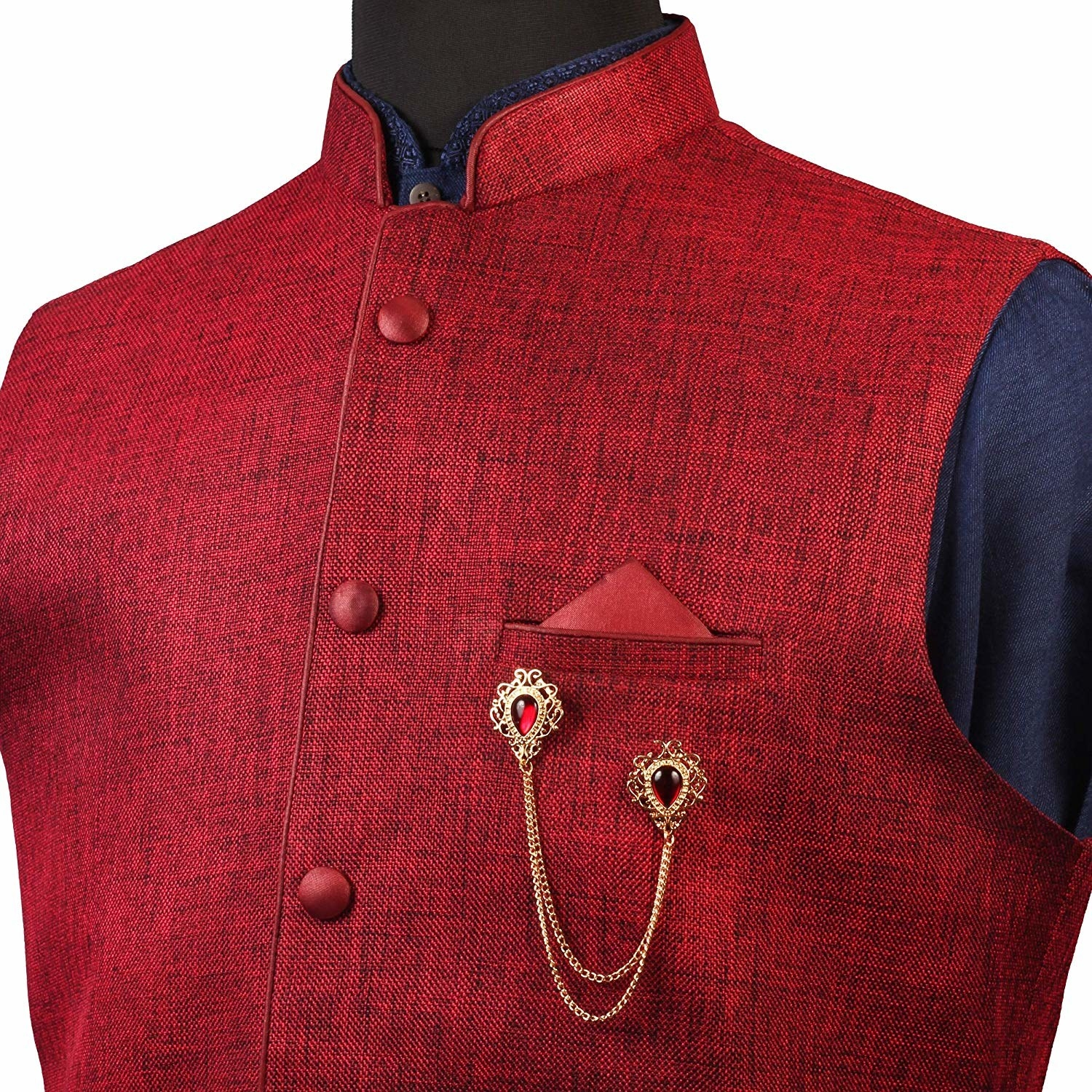 The brooch being showcased on a red Nehru jacket.