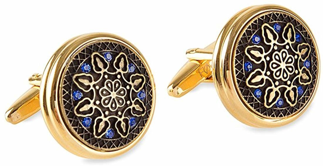 Cufflinks in gold, blue, and black.