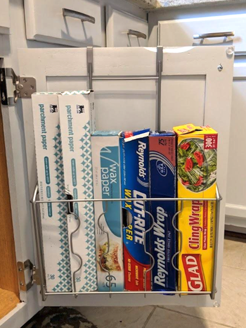 Reviewer with plastic wrap, tinfoil, and similar boxes inside organizer