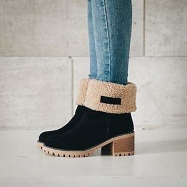 a model in the boots cuffed over with sherpa