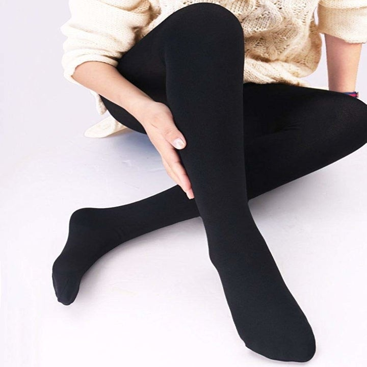 Model wearing tights with long sweater