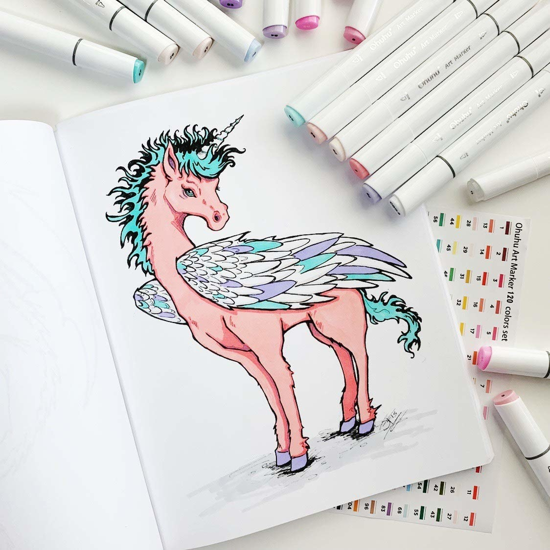 A picture of a unicorn that has been colored using the marker set around it