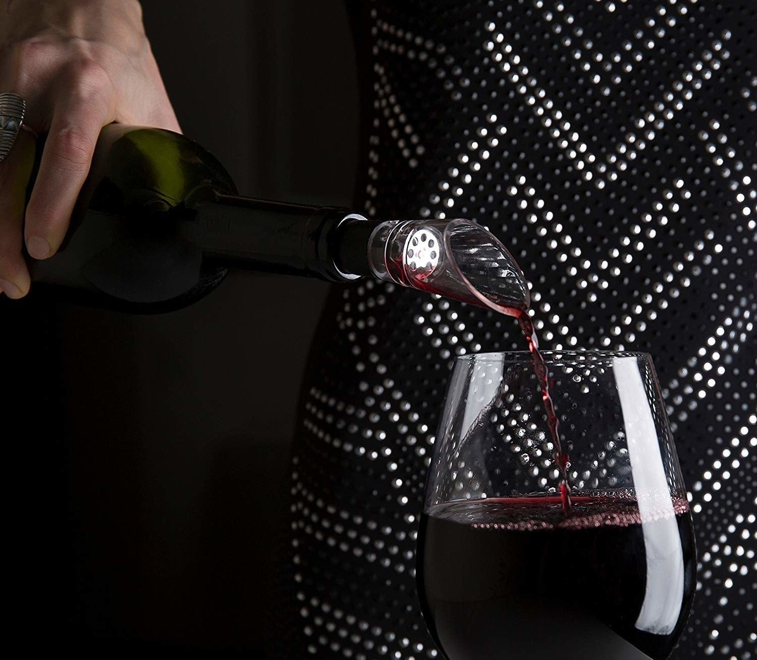 Wine being poured out with the decanter