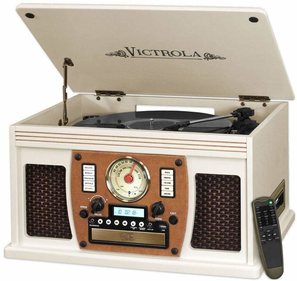 The white media center with a hinged record player top and remote