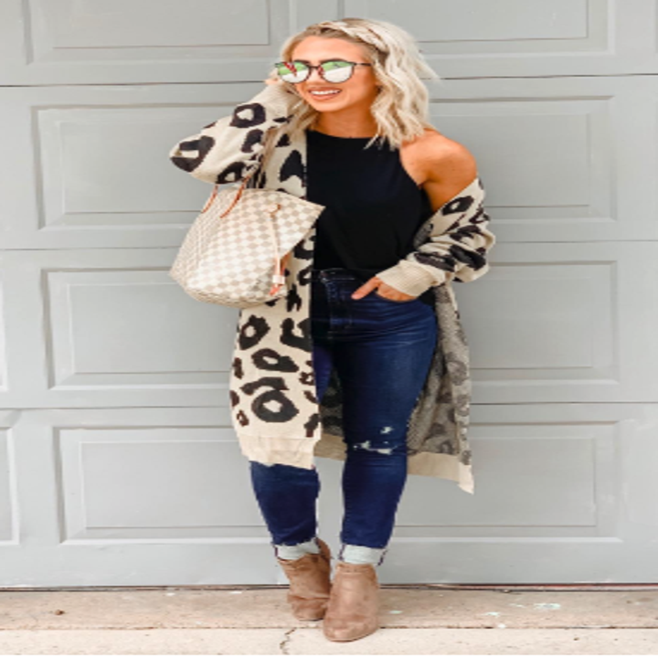 a reviewer in the long line open leopard print cardigan in tan and black