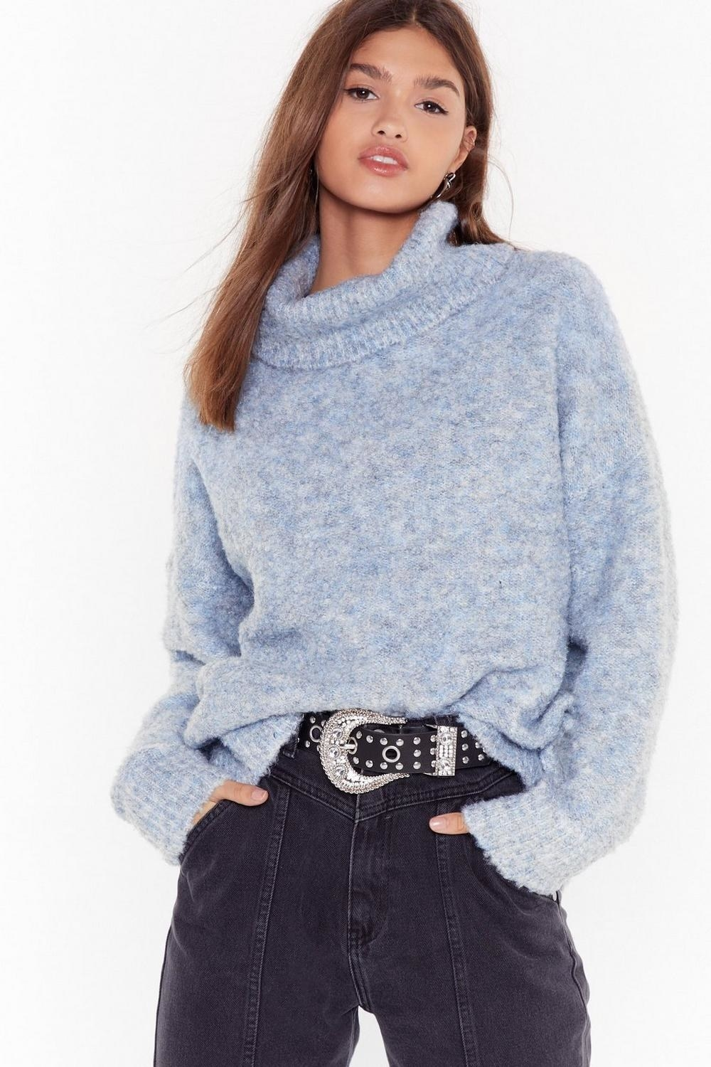 a model in the plush light blue sweater
