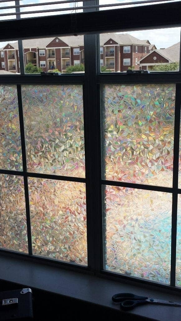 reviewer's window with holographic geometric frosted covering