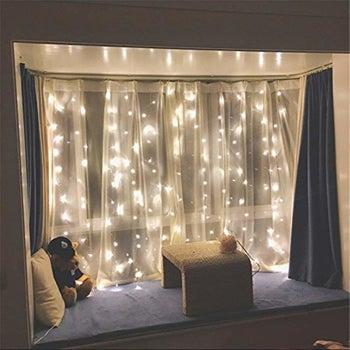 twinkle lights hanging in a window