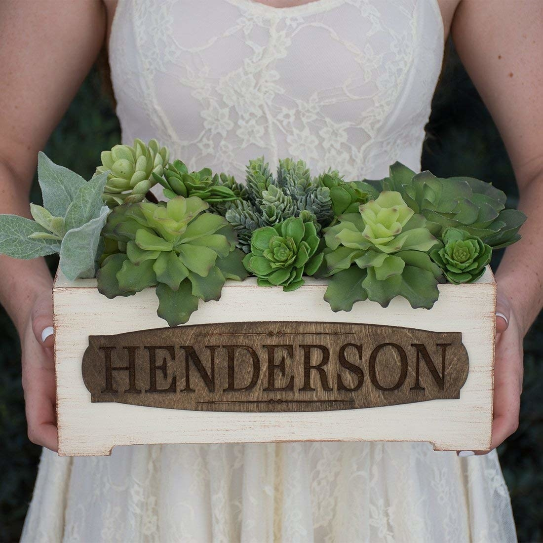Rustic box filled with succulents and name Henderson on front