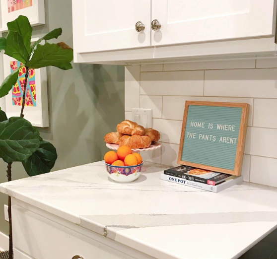 """Reviewer's letter board set up on kitchen counter with letters that read """"home is where the pants aren't"""""""