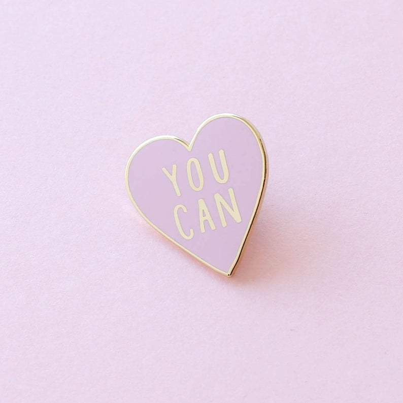 """Heart shaped pin with gold words that say """"You Can"""""""
