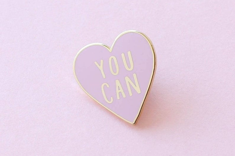 Heart shaped pin that says You Can