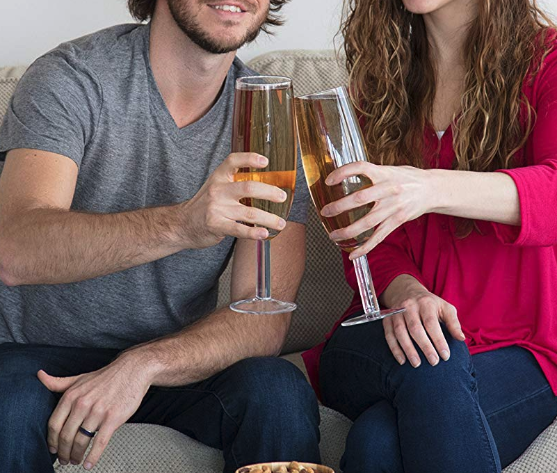 Two models clink the oversized prosecco glasses