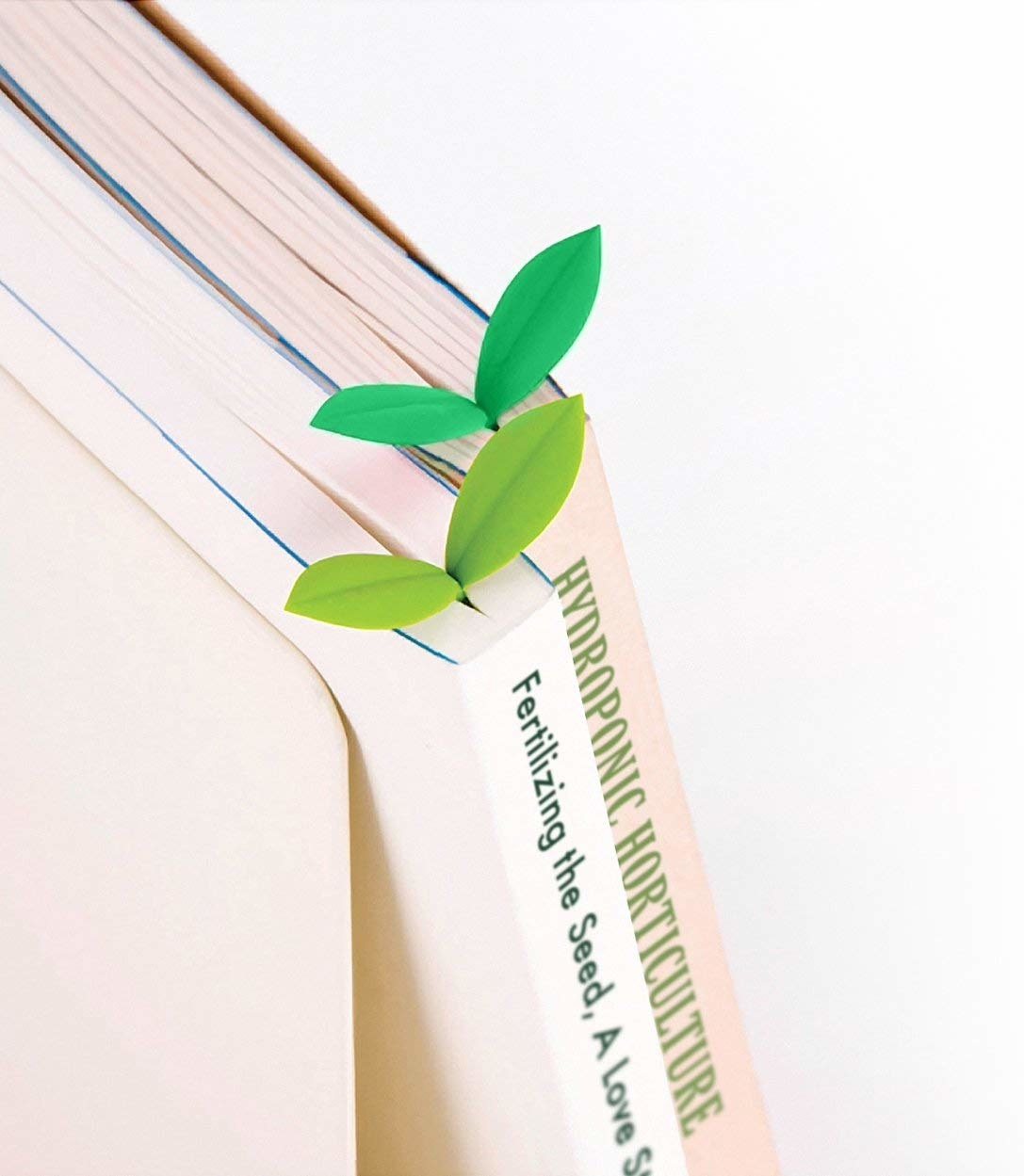 The tiny bookmarks sticking out the tops of books and looking like little leaves