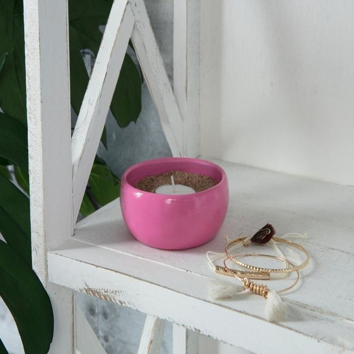 the pink dish on a shelf