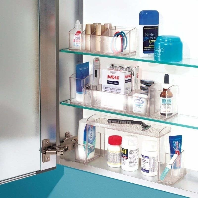 the clear organizers in a medicine cabinet, showing how they add more storage space