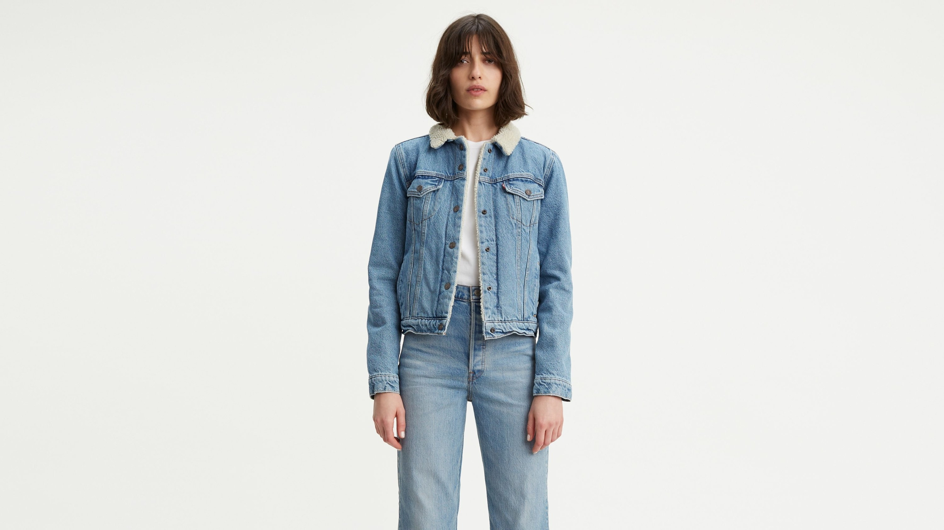 Model wearing the jacket in a light blue denim