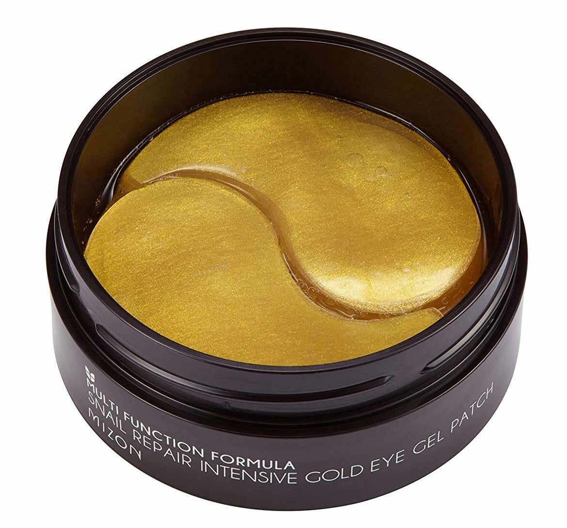 A jar of the eye masks in gold