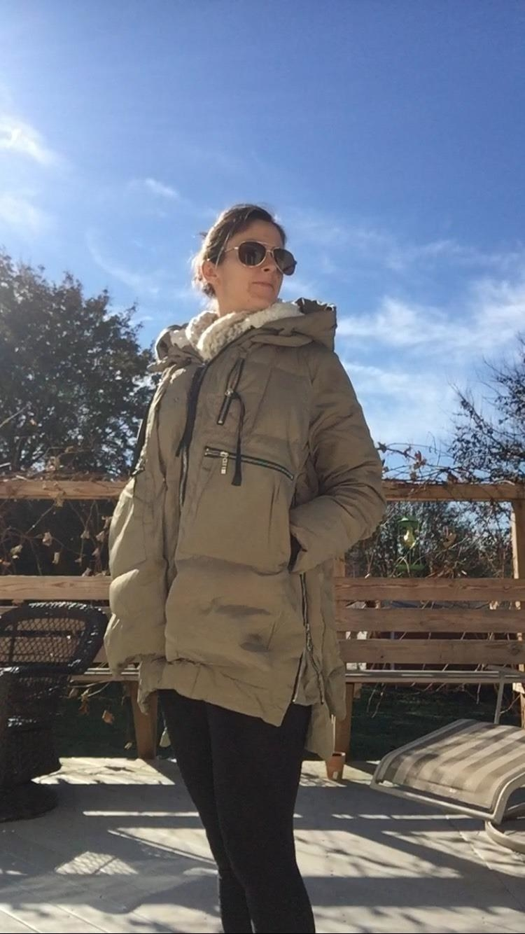 A reviewer in the green coat with sherpa-lined hood and pockets
