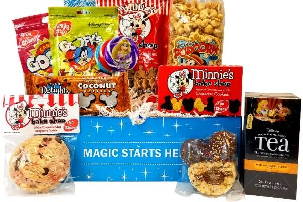a box filled with various disney snacks