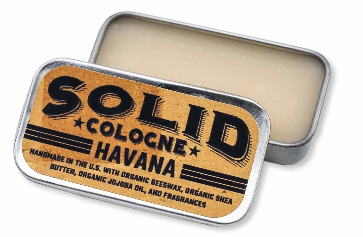 A small rectangular tin with the solid cologne inside