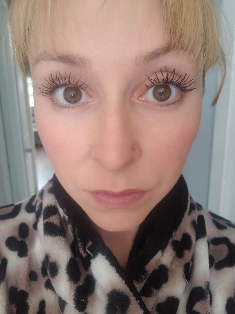 reviewer showing their long eyelashes