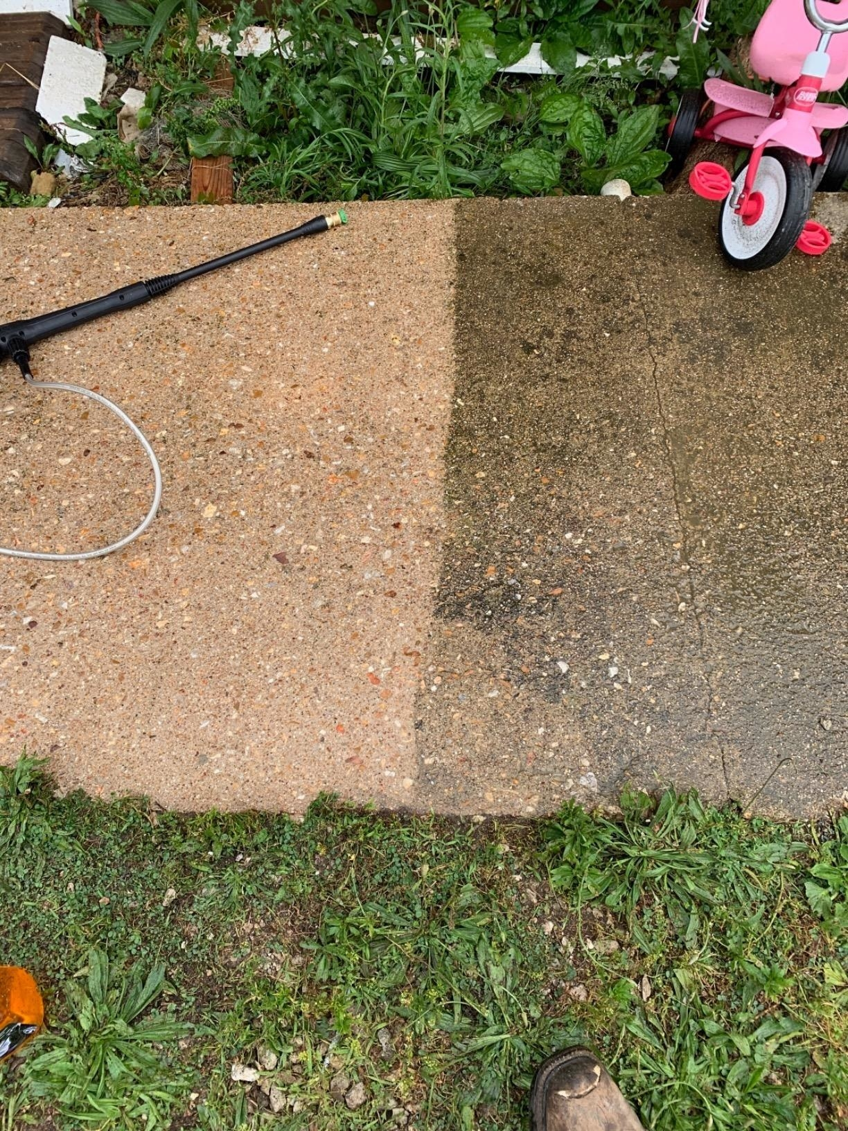 A reviewer showing a sidewalk before/after power washinig