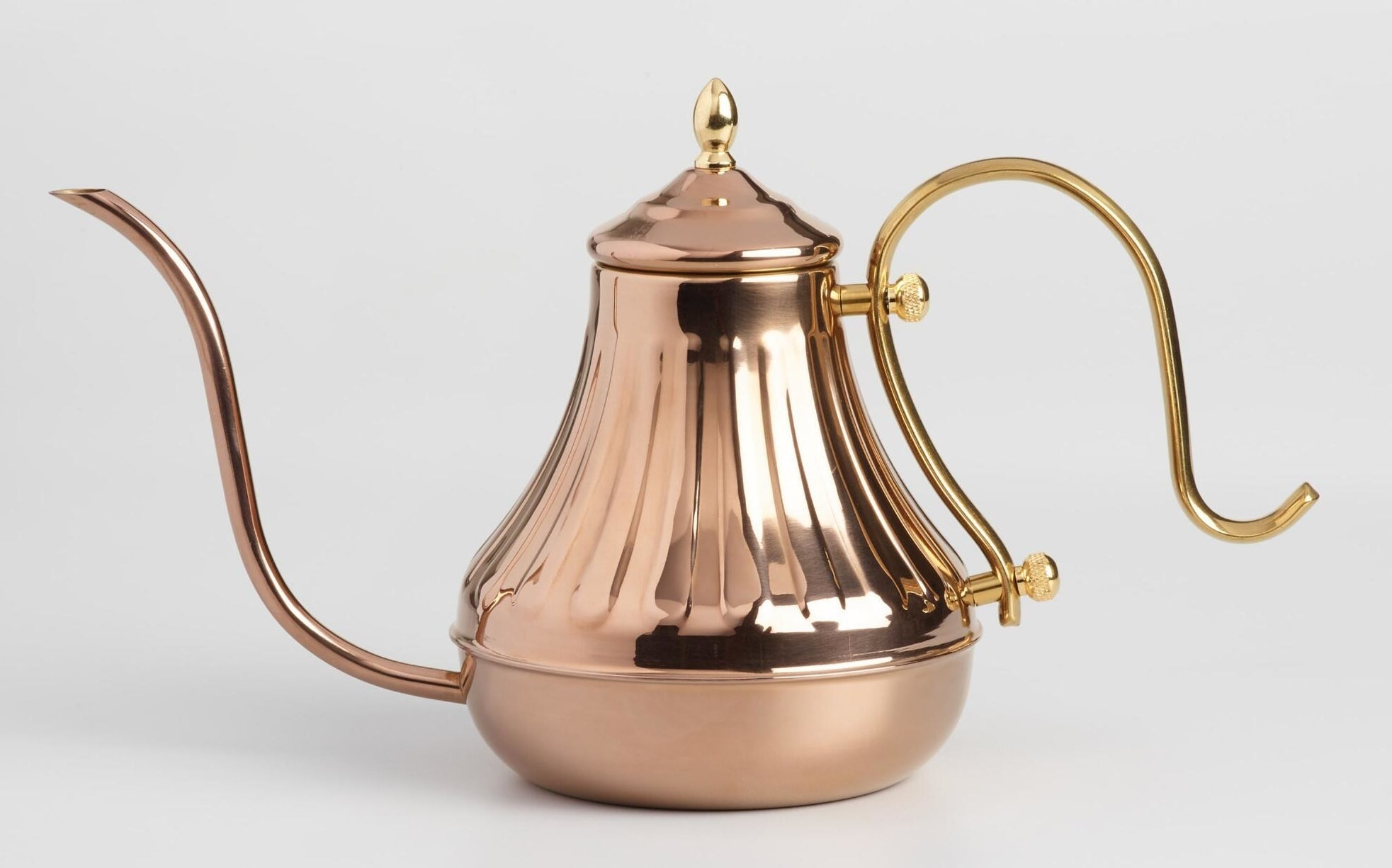 The copper kettle with a swoopy spout and handle in gold