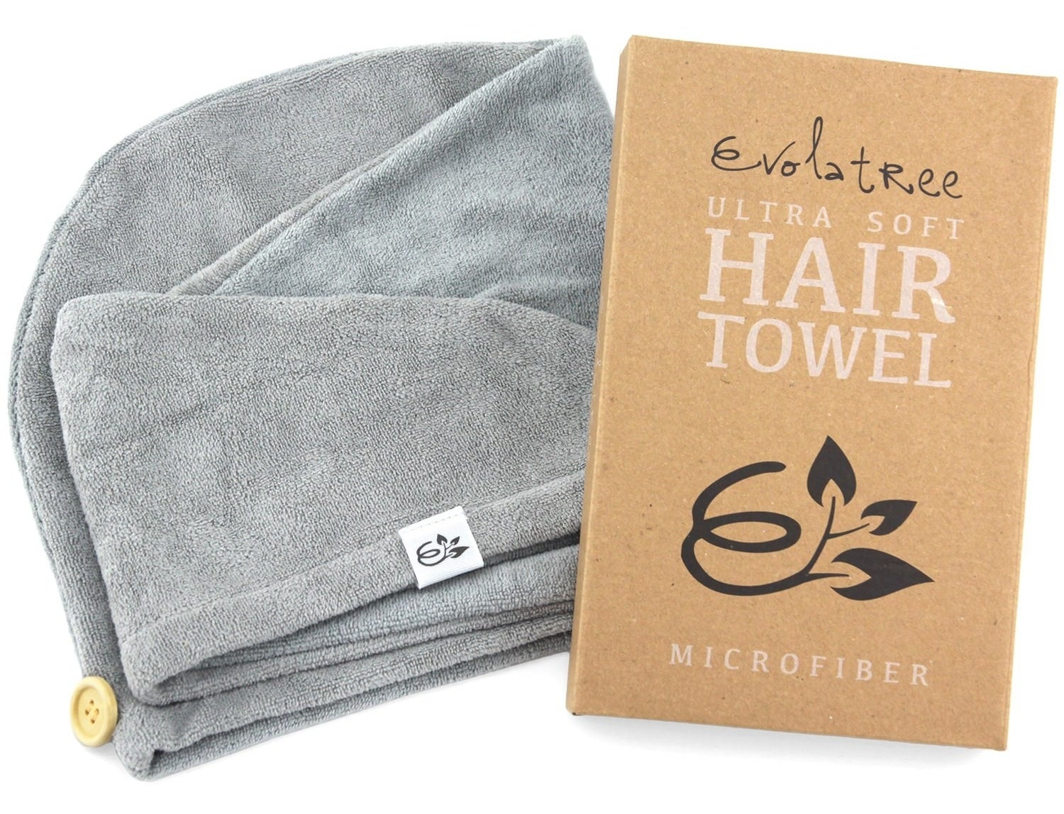 The microfibre hair towel next to its package