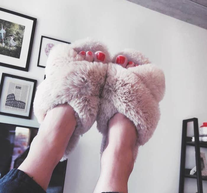 reviewer image of the criss-cross fuzzy open-toe slippers in light pink