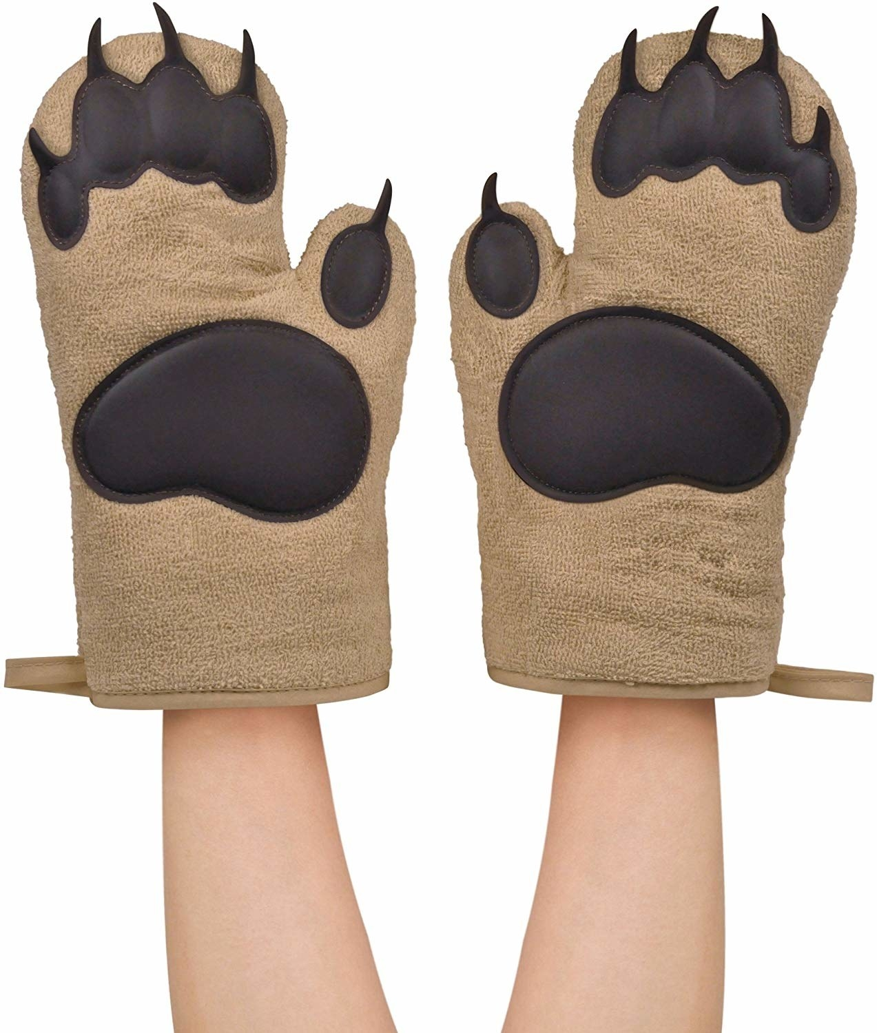a model wearing two oven mitts that look like bear paws