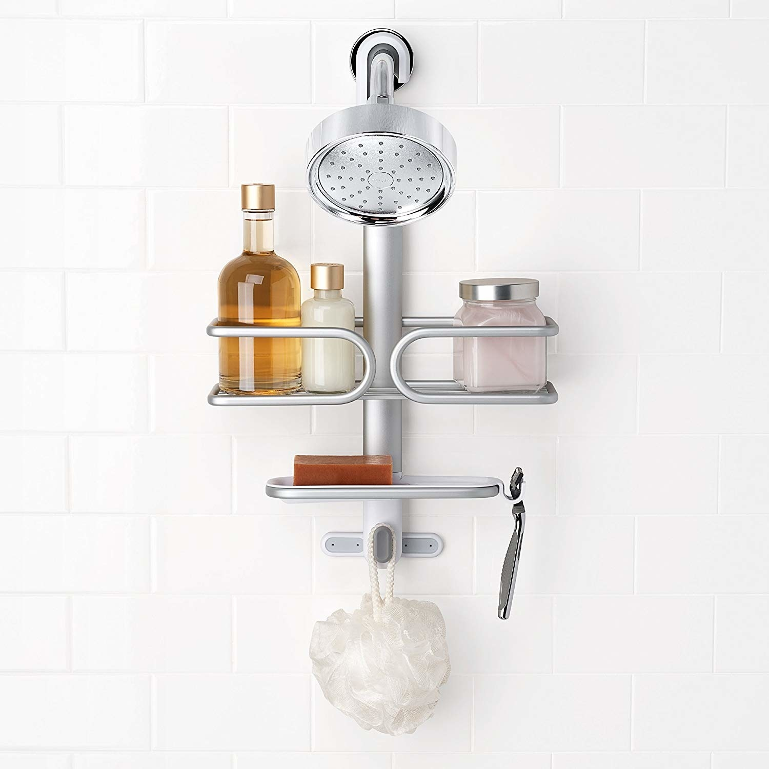 Shower caddy hanging from nozzle